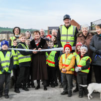 Crowlees Hoppa help Darren Smith Homes to mark the opening of the new slope down to the the canal path on Station Road.